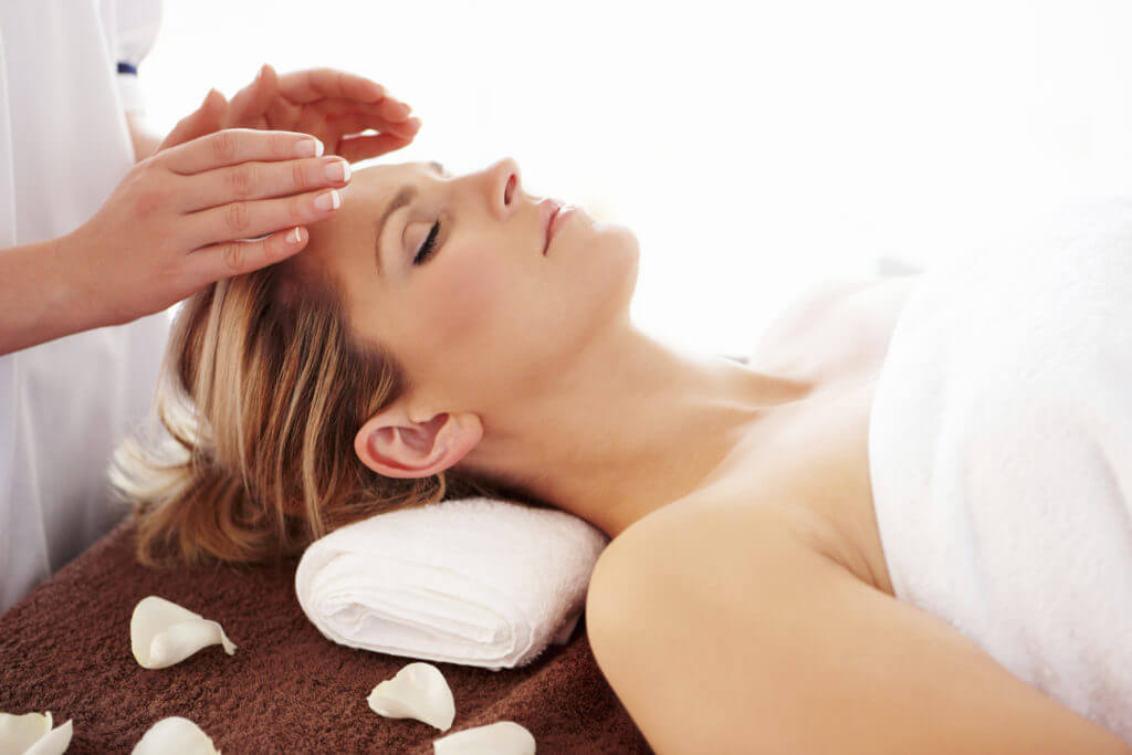 Woman Getting a Reiki treatment